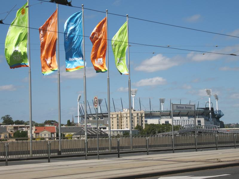 Commonwealth Games flags line many of Melbourne's streets, including Batman Avenue with the MCG (Commonwealth Games stadium) in the background