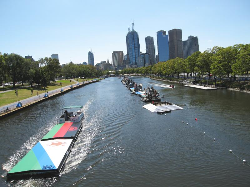 Work continues along the Yarra River near the Swan Street Bridge to hook up floating platforms in the shape and colours of each competing country's national flag Work continues along the Yarra River near the Swan Street Bridge to hook up floating platforms in the shape and colours of each competing country's national flag